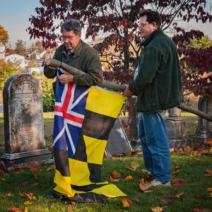 George Horvath and Don Vetter putting up the Calvert Arms-Grand Union flag
